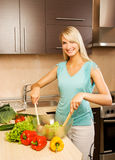 Woman mixing vegetable salad Stock Images