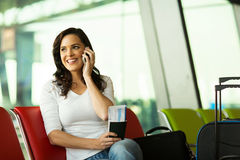 Woman mobile airport Royalty Free Stock Image