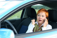 Woman with mobile in a car Royalty Free Stock Photo
