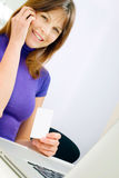 Woman with mobile holding health c Royalty Free Stock Photos