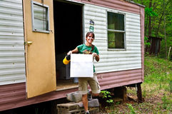Woman at a Mobile Home Stock Images