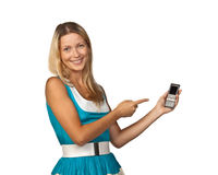 Woman with a mobile phone. The young woman with a mobile phone on a white background Royalty Free Stock Photography