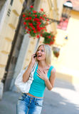 Woman with mobile phone Stock Photography