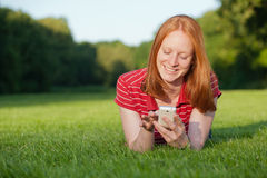 A woman with mobile phone Stock Photos