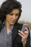 Woman and mobile phone Stock Images