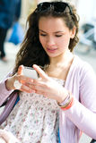 Woman with mobile phone Stock Images