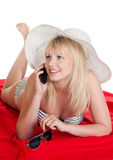 Woman with mobile phone. Happy young blond woman with mobile phone stock photography