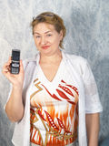 The woman with a mobile phone Royalty Free Stock Photography