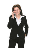 Woman With Mobile Phone. Nice young woman calling with business customer Stock Image