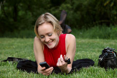 Woman with mobile phone. Young woman with mobile phone stock images