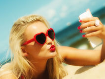 Woman with mobile phone on beach Stock Photos
