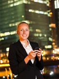 Woman with the mobile phone in the big city Royalty Free Stock Photography