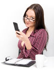 Woman with mobile phone and calendar Stock Photography