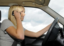 Woman with mobile phone in the car Royalty Free Stock Photos