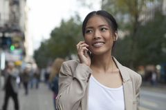 Woman and mobile phone Stock Photo
