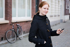 Woman with a Mobile Phone in a City Royalty Free Stock Image