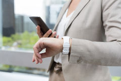 Woman with Mobile phone connected to a smart watch Stock Photos