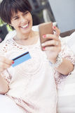 Woman with mobile phone and credit card Royalty Free Stock Photography