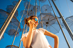 Woman with mobile phone on modern abstract Royalty Free Stock Photos