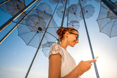 Woman with mobile phone on modern abstract Stock Images