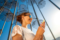 Woman with mobile phone on modern abstract Royalty Free Stock Photography