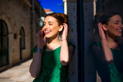 Woman with mobile phone in old city street Royalty Free Stock Photos