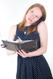 Woman with mobile phone and organizer Stock Photo