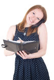 Woman with mobile phone and organizer Royalty Free Stock Image