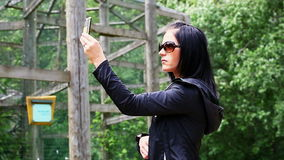 Woman with mobile phone stock footage