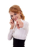 Woman on mobile phone pointing to you Royalty Free Stock Images