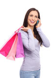 Woman with mobile phone and shopping bags Stock Photography