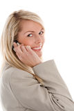 Woman on mobile phone smiling Stock Photography