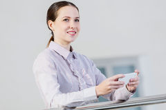 Woman with mobile phone Stock Image