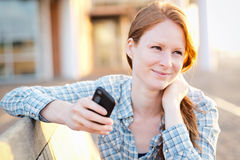 Woman with a Mobile Phone at Sunset Stock Photo