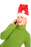 Woman with mobile and Santa Hat Royalty Free Stock Images