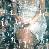 Woman with mobile smart phone with binary code background. Close up of a blonde woman using mobile smart phone with binary code numbers background royalty free stock image