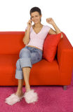 Woman with mobile on the sofa royalty free stock images