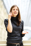 Woman with mobile telephone Royalty Free Stock Photos