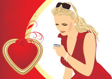 Woman with a mobile telephone. Valentines day Royalty Free Stock Photos