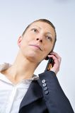 Woman with mobile and white background Stock Images