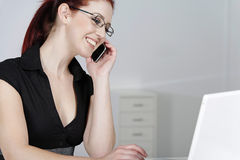 Woman on mobile at work Stock Image