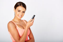 Woman with a mobilephone. Pretty woman with a mobilephone in white studio Royalty Free Stock Photos