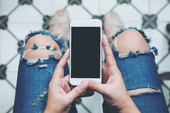 Woman and mock up smart phone Stock Images