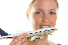Woman with model airplane stock photo