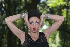 Woman model. Woman with arms in the face Royalty Free Stock Images