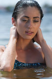 Woman model at the beach in bright sunlight. Stock Image