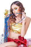 Woman model with bright make-up and beads Royalty Free Stock Photo