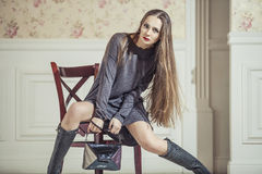 Woman model in dress with fashionable boots and bright red lips Royalty Free Stock Photo