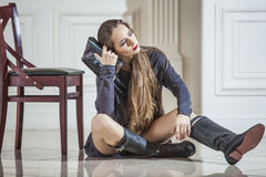 Woman model in dress with fashionable boots and bright red lips Royalty Free Stock Photography