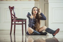 Woman model in dress with fashionable boots and bright red lips Royalty Free Stock Photos